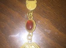 ميدالية نحاس لها شكل عربي أسطوري بها حجر عقيق اصلي 100٪