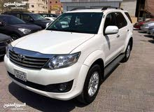 Rent a 2014 Toyota Fortuner with best price