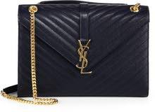 women Saint Laurent handbag