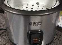 طباخ الأرز الكهربائي cooks rice