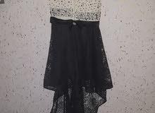 فستان مع شاحط ولمعة ناعمة وطبقة شيفون جميلة