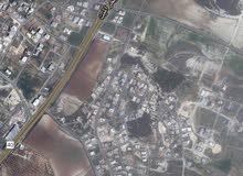 ارض للبيع بلعاس على شارعين مساحه 860 متر تصلح لانشاء فيلا