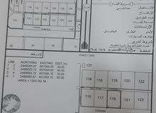 للبيع ارض بمخطط صناعية سناو بجنب البنايات والمحلات