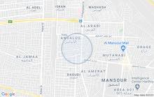 قطعة ارض فارغة مساحة 300 متر واجهة 11 متر موقع تجاري بالمنصور شارع 14 رمضان