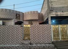 بيت مساحته 400 م. للبيع ابي الخصيب/حمدان/عالشارع العام تجاري بي 4 محلات وكوفي.