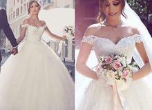 بدلة عروس ابيض