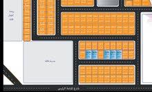 أراضي تجارية بعجمان على 12 شهر بالمنامه مخطط الزهور من المالك
