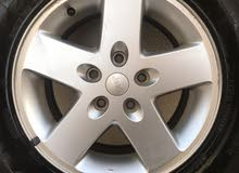 4 original jeep wrangler wheels with tires 265/70/Ram 17 for sale