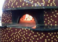 فرن بيتزا إيطالي من الطوب الحراري والاسمنت الحراري الفرنسي ملحق به بلاط حراري