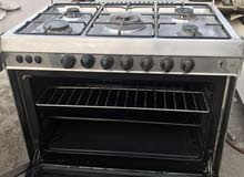 5 burner gas oven neat and clean in good working conditon