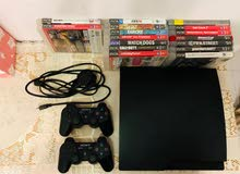 PS3 WITH 2 CONTROLLERS AND 16 GAMES.