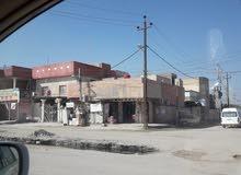 بيت ركن في القبلة على الشارع العام تجاري