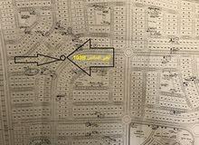 قطعة ارض للبيع في الحي السادس علي شارع رئيسي 32 متر رقم (103B)