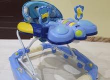 عربية اطفال جديده ستخدم ثلاثه شهور فقط البيع  تتحول الي كرسي هزازز