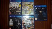 ps4 games :fifa17,assassins creed unity,gta v,injustice 2,last of us+dlc