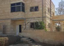 منزل طابقين حجر اربع واجهات - للبيع في حي الرشيد - شارع ياجوز