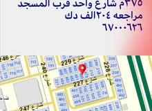 للبيع ارض فضاء ابوفطيره مساحه 375م شارع واحد قرب المسجد