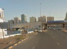 ارض تجارية علي زاويه شارع الشيخ خليفة وشارع السفير ميني مول وجسر غلفا مساحه الارض 10 الاف قدمQRR