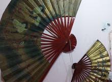 لوحات خشبيه على شكل مروحه يابانيه احجام كبيره عدد 2 بسعر 75 ونهائي