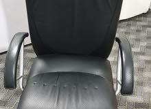 كرسي مكتبه