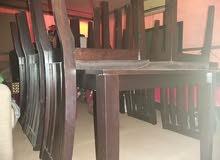 طاولة طعام لون بني غامق من صفاة الغانم
