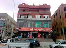 مول تجاري للبيع بارقي شوارع مدينة بدر شارع الجامعه