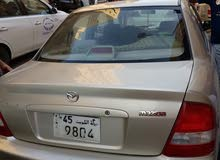 Mazda 323 2004 For sale - Gold color