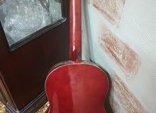 جيتار نوع سوزوكي مع شنته