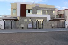 Al Maabilah neighborhood Seeb city - 435 sqm house for sale