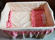 سرير طفل بحالة جيدة