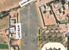 قطعة أرض للبيع في طمينة طريق المعصرة مساحتها هكتار واحد