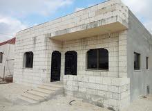 مادبا مقابل مسجد الوهاب منزل مستقل واجهة حجر للبيع