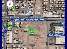أرض سكنية بحي اليرموك على شارع عرض 20 متر