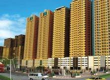 شقه ثلاث غرف وصاله للبيع في عجمان علا شارع لامارات مباشره