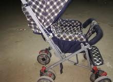 عربة أطغال + مقعد سيارة للأطفال   بحاله ممتازة جدا