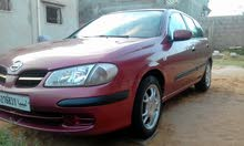 Maroon Nissan Almera 2002 for sale