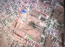 ارض 3 شوارع قطران فرع من طريق طرابلس سكن تجاري