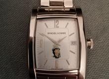 ساعة سويسرية اصليه عليها صورة معمر القدافي جديدة