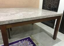 marble and wood dining table