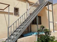 درج حديد بطول 5متر للبيع مع باب صغير بطول متر