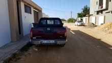 Maroon Nissan Navara 2009 for sale