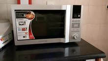 Daewoo microwave oven with steam self cleaning and other multiple features for sale