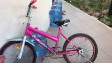 girls pink Barbie bicycle which is in very good condition
