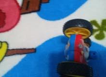 لعبة سيارة سباق تحكم عن بعد و سفينة مائية