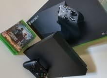 Xbox one x معاه 4العاب جديد مستعمل يوم واحد فقط