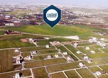 قطعة أرض بأجمل مواقع طريق المطار بالقرب من ايكيا للبيع كاش او اقساط معفاه من رسوم التسجيل
