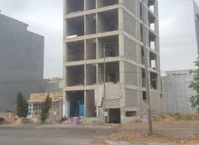 عمارة في اربيل على شارع 100 متري مقابل امباير بالقرب من فندق جهينة