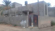 منزل للبيع واجهتين عالقطران حي سكني تاجوراء سوق السبان الشارع امام المصرف325ألف