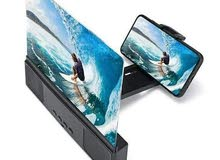 شاشة مكبرة للهاتف مزودة بسماعتين لتكبير الصوت بحجم 10 بوصة ( 25 سم ) تأتي بلوح