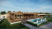 متخصصين في انشاء البيوت الخشبيه والبرجولات وديكورات الاخشاب